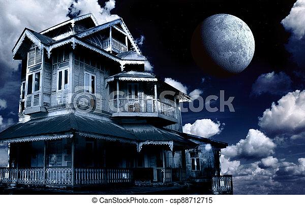 Haunted house. Old abandoned house on night sky background - csp88712715