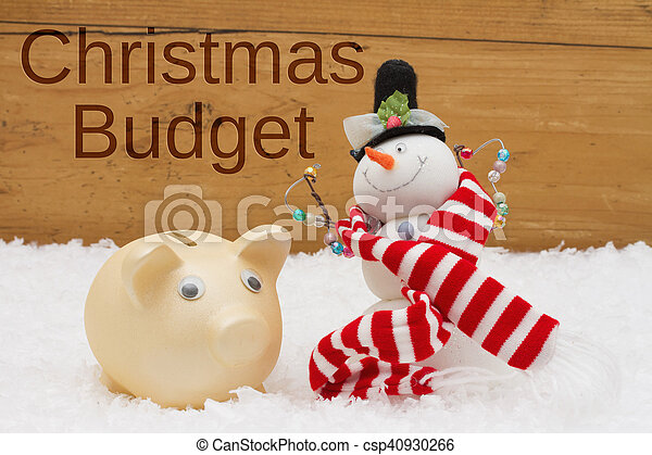 Having a Christmas Budget, Piggy bank and Snowman with scarf on snow - csp40930266