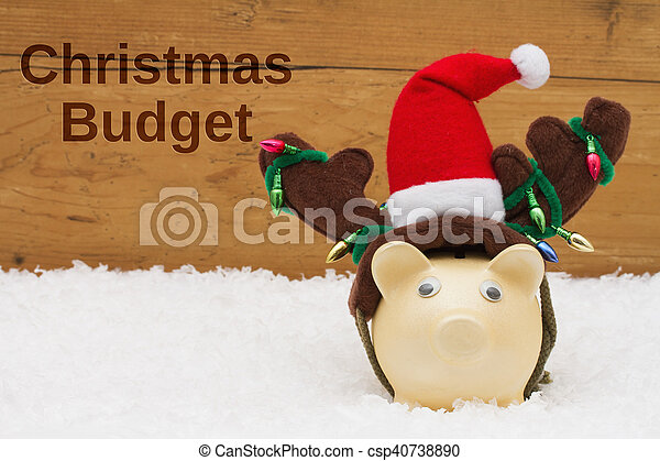 Having a Christmas Budget, Piggy bank with Christmas hat on snow - csp40738890