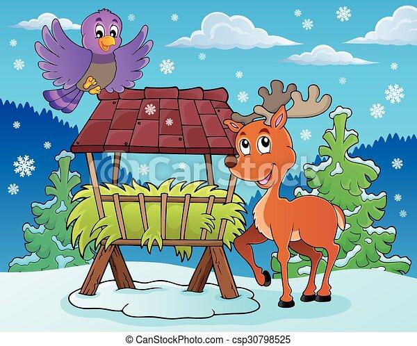 Hay rack with reindeer and bird - csp30798525