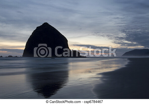 Haystack Rock on Cannon Beach Oregon Evening - csp6784467