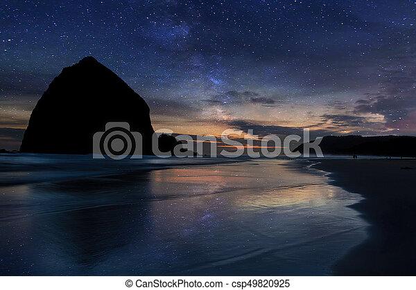Haystack Rock under Starry Night Sky - csp49820925