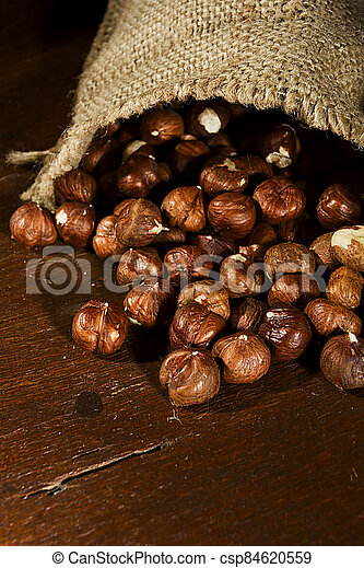 Hazelnuts in a bag - csp84620559