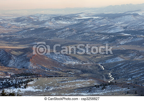 hazy winter view of Colorado Rocky Mountains - csp3258827