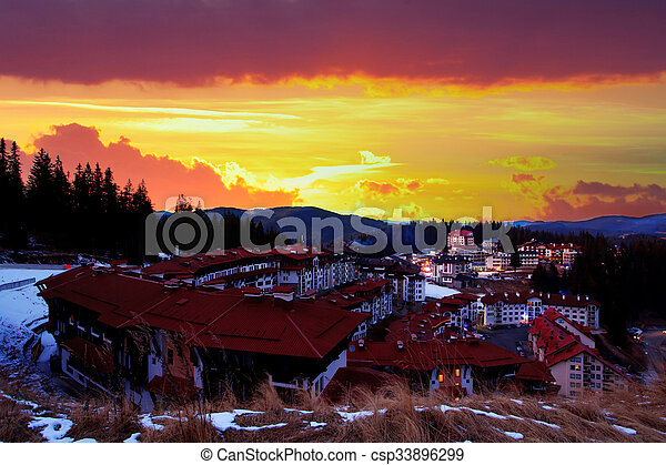 HDR red sunset over the Pamporovo resort - csp33896299