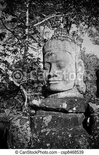 Head of gate guardian, Angkor, Cambodia - csp8468539