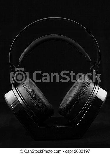 Headphones on black background - csp12032197