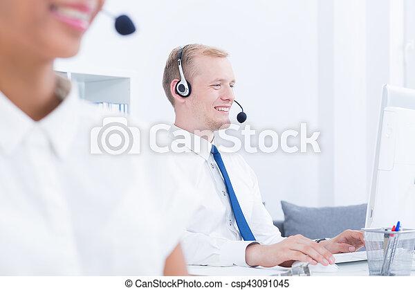 Headphones on heads of telemarketers - csp43091045