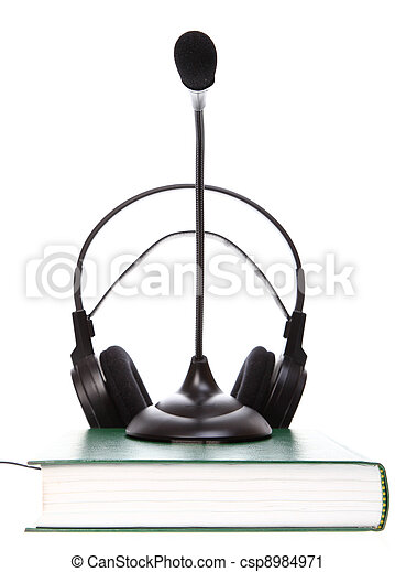 headset with a microphone, hardcover books stack isolated - csp8984971