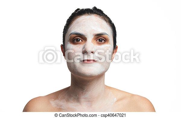 Headshot of woman with cream - csp40647021
