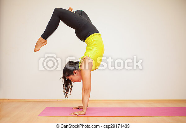headstand with crossed legs pretty brunette doing a