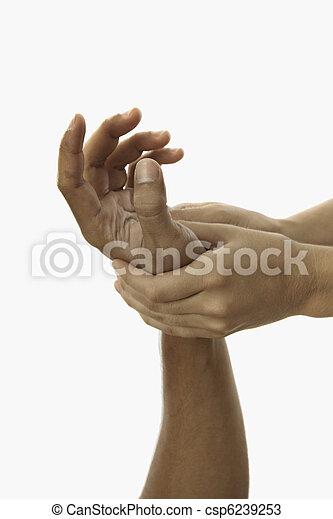 healing touch of a masseus's hands  - csp6239253