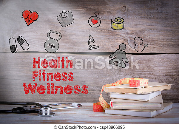 Health, Fitness, Wellness. Stack of books and a stethoscope on a wooden background - csp43966095