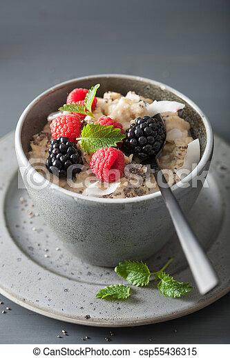 healthy breakfast oatmeal porridge with raspberry blackberry - csp55436315
