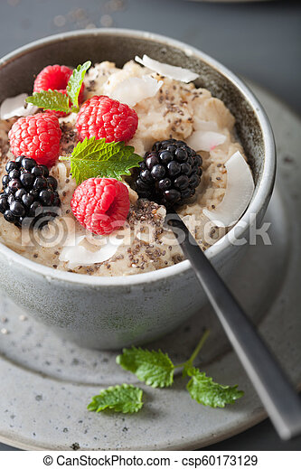 healthy breakfast oatmeal porridge with raspberry blackberry - csp60173129