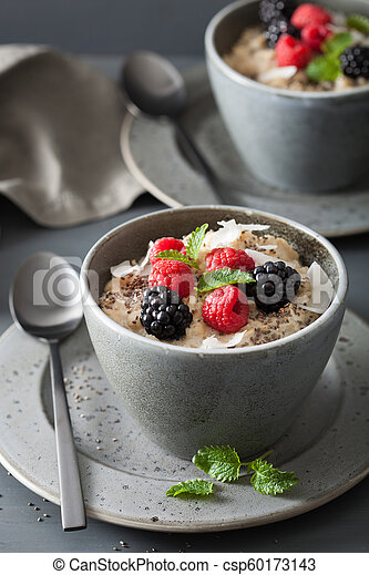 healthy breakfast oatmeal porridge with raspberry blackberry - csp60173143