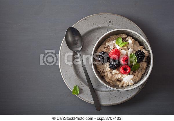 healthy breakfast oatmeal porridge with raspberry blackberry - csp53707403