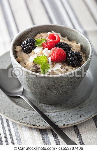 healthy breakfast oatmeal porridge with raspberry blackberry - csp53707406