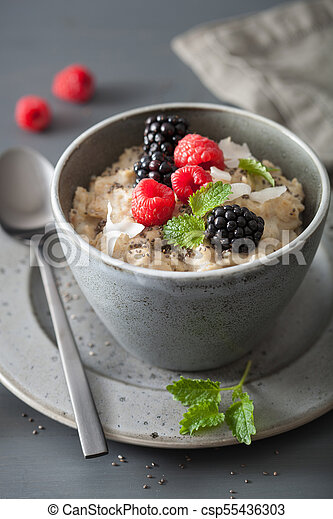 healthy breakfast oatmeal porridge with raspberry blackberry - csp55436303