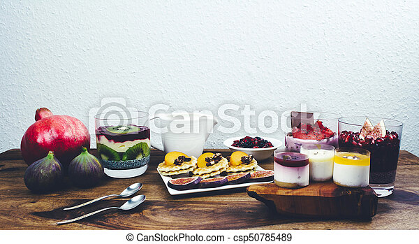 Healthy breakfast on rustic wooden table. - csp50785489