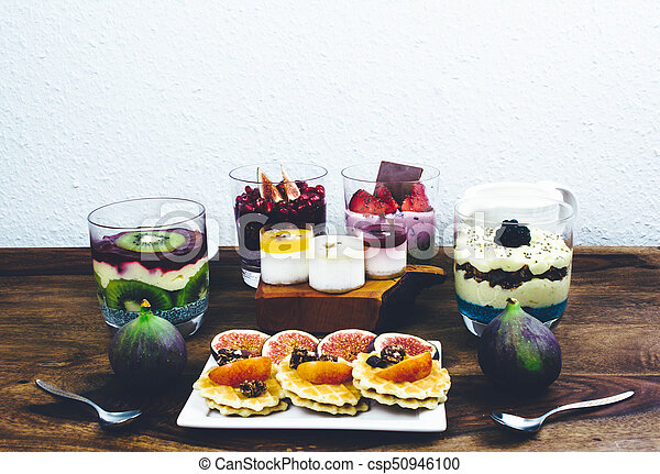 Healthy breakfast on rustic wooden table. - csp50946100