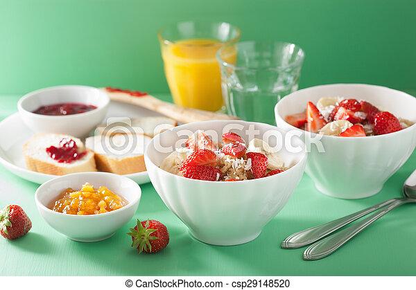 healthy breakfast quinoa with strawberry banana coconut flakes - csp29148520