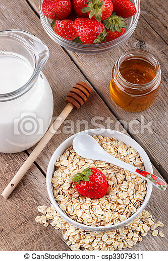 Healthy cereal with milk, honey and strawberry - csp33079311