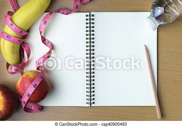 Healthy eating concept, tape measure, fruit and water bottle on a wooden background, blank copy space notebook - csp40905493