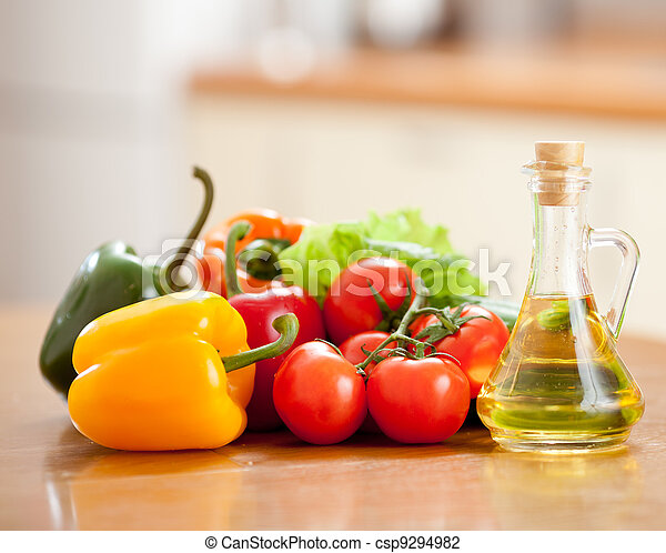 Healthy food fresh vegetables peppers and tomatoes on the table in kitchen - csp9294982