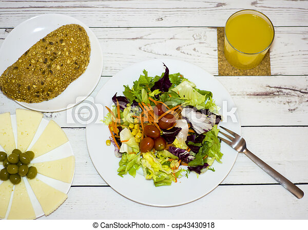 Healthy food on a white wooden table - csp43430918