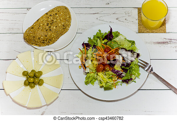 Healthy food on a white wooden table - csp43460782