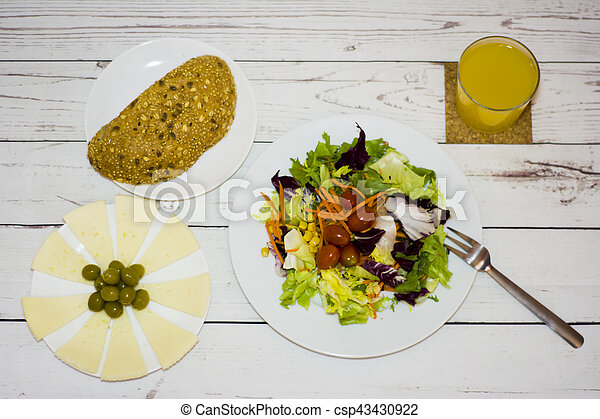 Healthy food on a white wooden table - csp43430922
