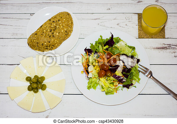 Healthy food on a white wooden table - csp43430928