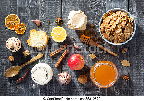 healthy food on wooden table - csp55312879