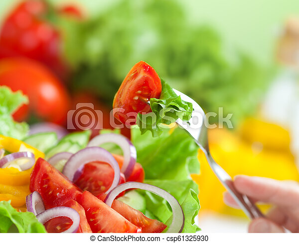 Healthy food or fresh vegetable salad meal concept - csp61325930