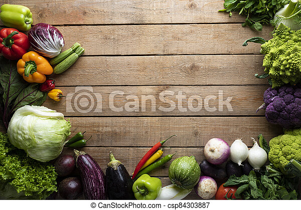 Healthy food, vegetables on a wooden table - csp84303887