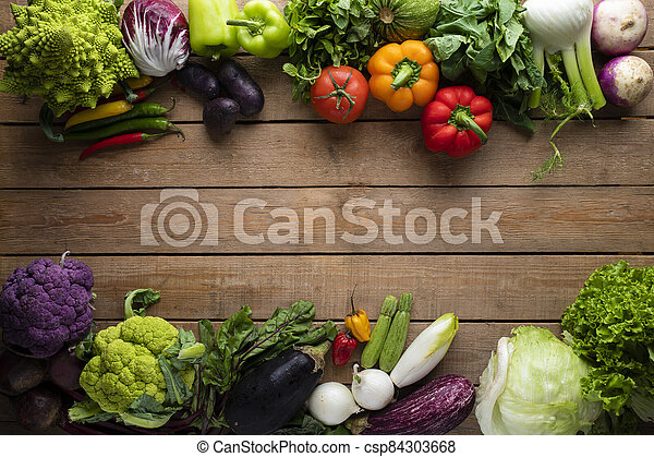 Healthy food, vegetables on a wooden table - csp84303668