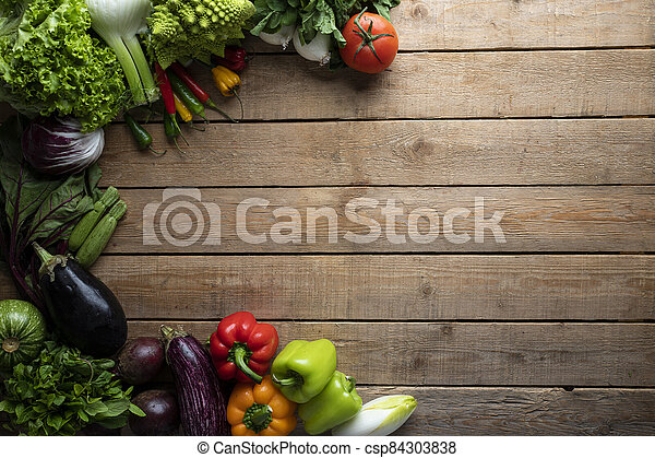 Healthy food, vegetables on a wooden table - csp84303838