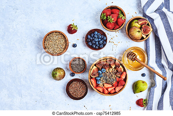 Healthy Homemade Oatmeal with Berries and seeds for Breakfast - csp75412985