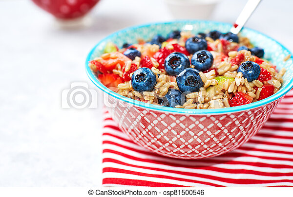 Healthy Homemade Oatmeal with strawberries, blueberries for Breakfast - csp81500546