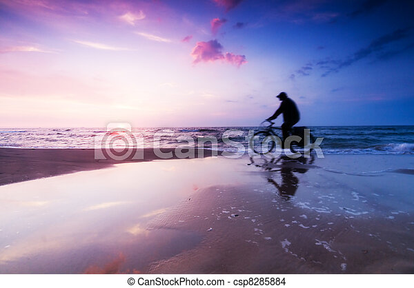 Healthy lifestyle, beach at sunset - csp8285884