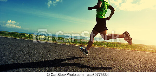healthy lifestyle woman runner running on road - csp39775884