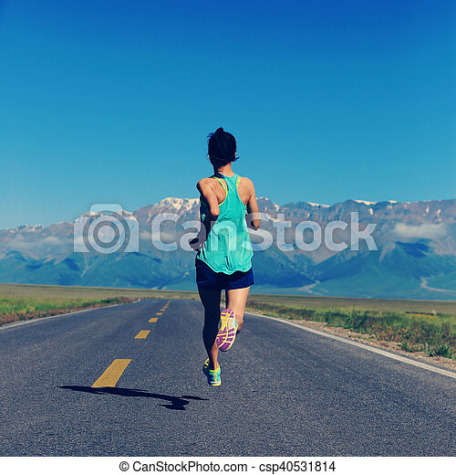 healthy lifestyle young fitness woman runner running on road - csp40531814