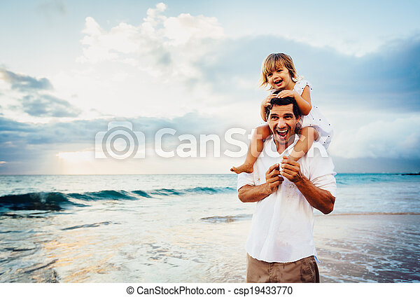 Healthy loving father and daughter playing together at the beach at sunset Happy fun smiling lifestyle - csp19433770