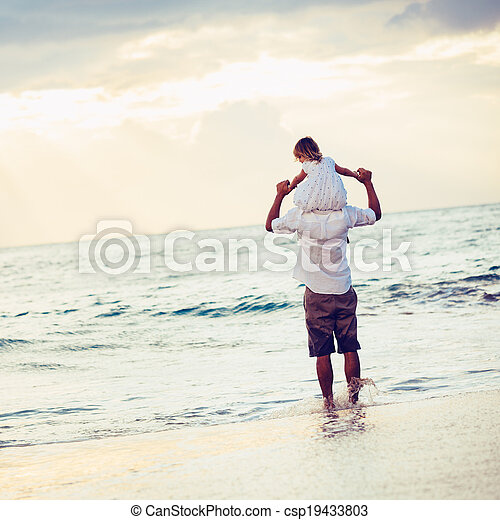 Healthy loving father and daughter playing together at the beach at sunset Happy fun smiling lifestyle - csp19433803