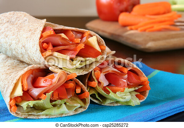 Healthy lunch, ham, cheese and vegetables wrapped in a whole wheat tortilla. - csp25285272