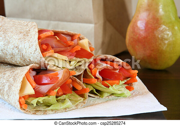 Healthy lunch, ham, cheese and vegetables wrapped in a whole wheat tortilla. - csp25285274