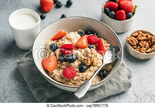 Healthy Oatmeal Porridge With Summer Berries - csp78851776