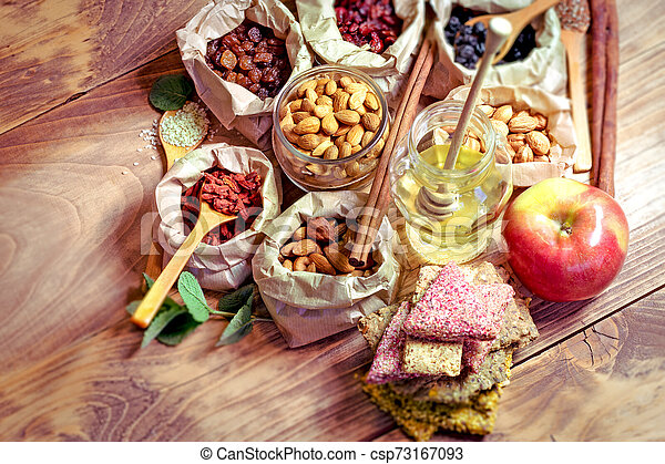 Healthy organic food, healthy vegetarian food on wooden table - csp73167093