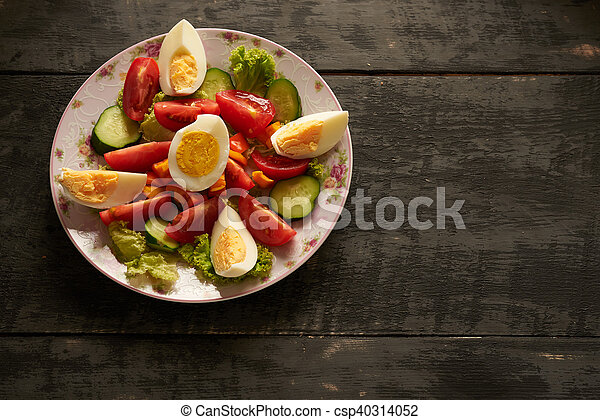 healthy salad on a wooden table - csp40314052